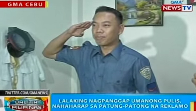The Fake Policeman doing a salute in front of the media.