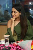 Pragya Jaiswal in a single Sleeves Off Shoulder Green Top Black Leggings promoting JJN Movie at Radio City 10.08.2017 033.JPG