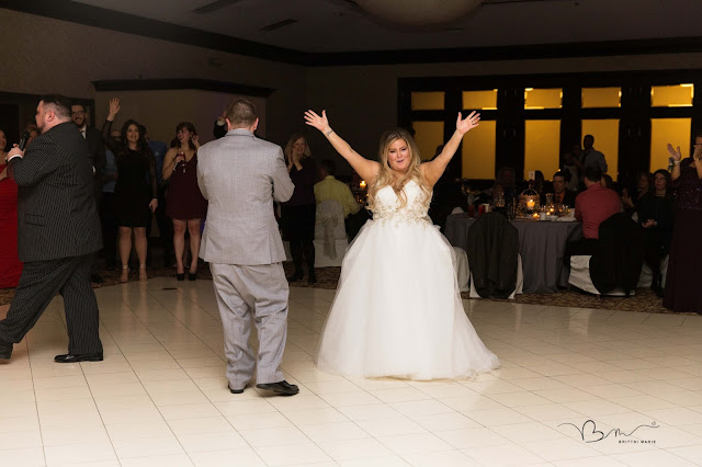 bride and grooms first dance at italian american cultural center in clinton township