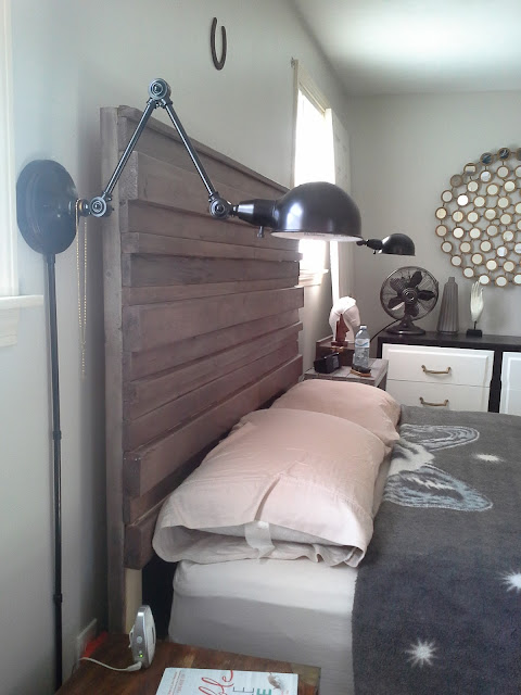 Master bedroom, wall lamp, rustic headboard