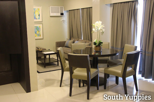 Dining area and living room of Bellini Suites