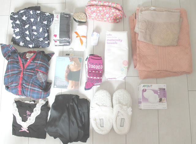pregnancy hospital bag clothes and toiletries for mum to be pyjama bottoms, two nighties, slippers, black dressing gown, big black knickers, maternity towels. hand held fan, nursing bras, breast pads, socks and towels