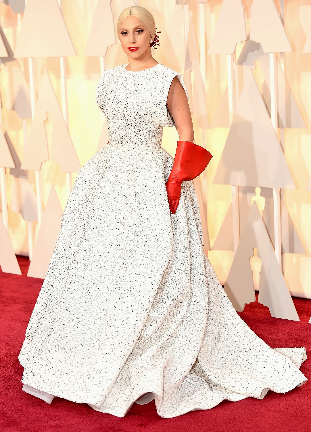 Lady Gaga wears an Azzedine Alaia gown to the 2015 Oscars in Hollywood