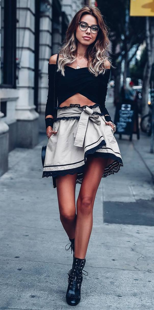 how to wear a black top : bag + skirt + lace up boots