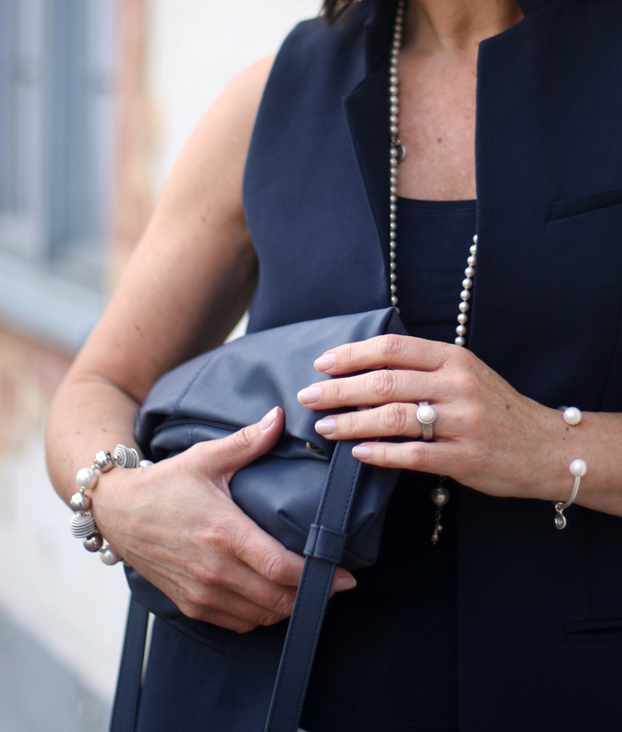 Long Blue Vest by Zara and pearl jewellery classic style