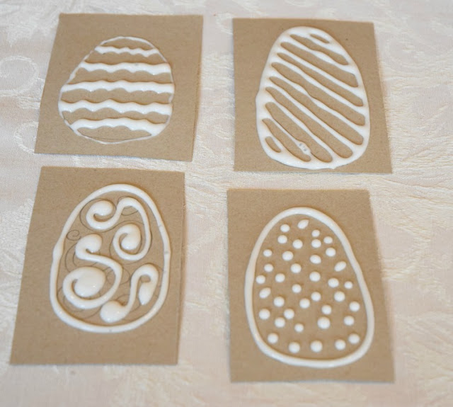 DIY crayon rubbing plates with spring or Easter designs. Make Easter eggs, flowers, bunnies, or chicks with this fun fine motor activity for preschoolers, kindergartners, or elementary children.