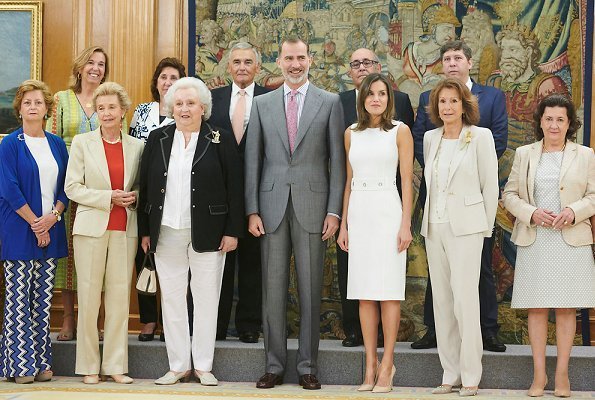Queen Letizia wore Prada pumps, Tous pearl earrings. Princess Pilar de Borbon Nuevo Futuro Association (New Future)