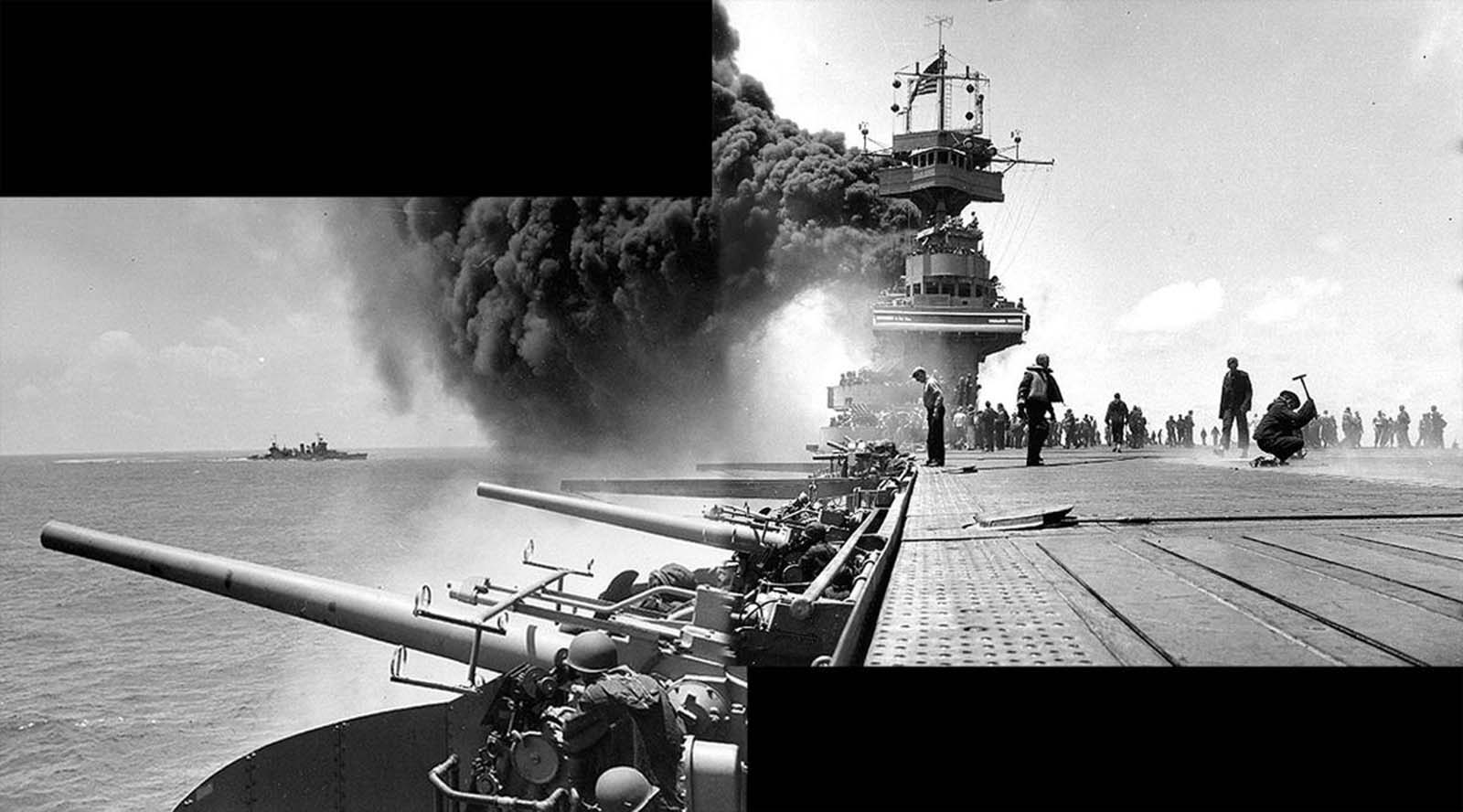 Scene on board USS Yorktown, shortly after she was hit by three Japanese bombs on June 4, 1942. The dense smoke is from fires in her uptakes, caused by a bomb that punctured them and knocked out her boilers. Panorama made from two photographs taken by Photographer 2rd Class William G. Roy from the starboard side of the flight deck, just in front of the forward 5