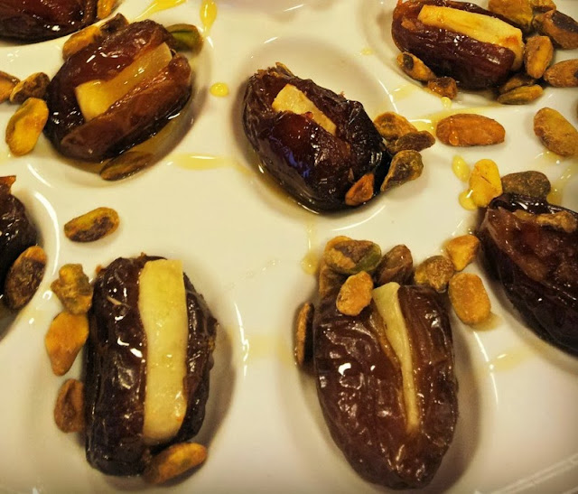 Dates stuffed with Manchego Cheese and Topped with Pistachios and Honey.