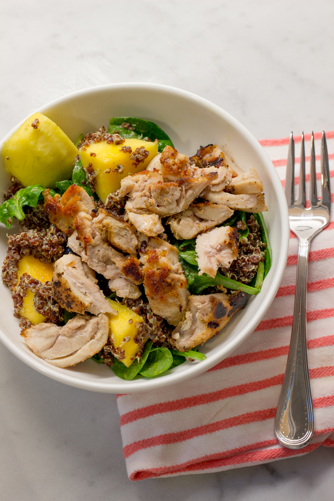 sliced up that chicken mixed the dressing in with some spinach leaves mangos and blueberries then added the quinoa to it all that was it