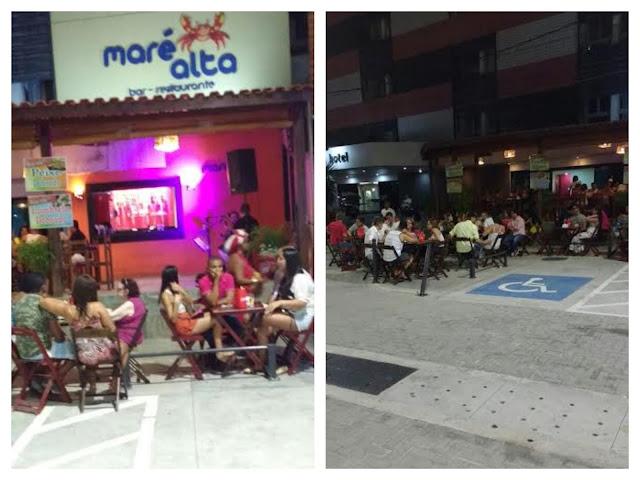 Bar ocupa passeio e estacionamento na Mariquita