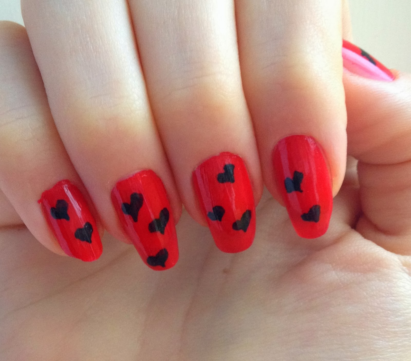 red-and-black-heart-nails