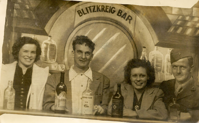 "Cousins Ralph ""Bucky"" Moore and Jack O'Hare with their wives, Theresa (left) and Martha (right) pose at the ""Blitzkreig Bar"", c. 1945, taken in New York while Jack was on furlough."