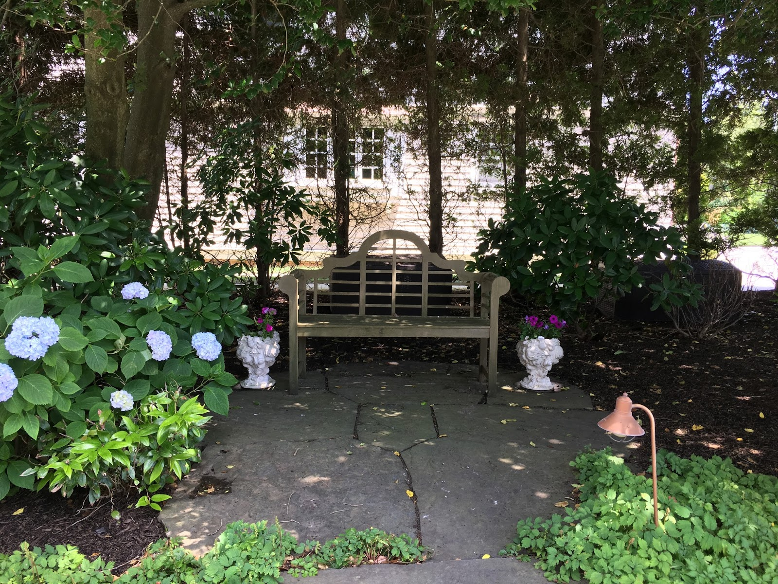 Garden bench in backyard of home garden tour