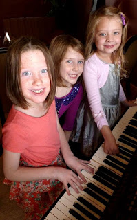 THree family members enjoying playing a Kawai CP baby grand digital piano