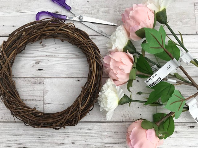 Rattan wreath, flowers and scissors