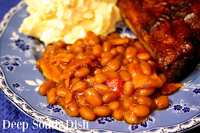 These bourbon baked beans are a perfect classic side for anything grilled or smoked, pulled pork, burgers and dogs, chicken or ribs. Made with beans and bacon, chopped onion and sweet bell pepper and a savory, sweet and spicy sauce, made easy using a slow cooker.