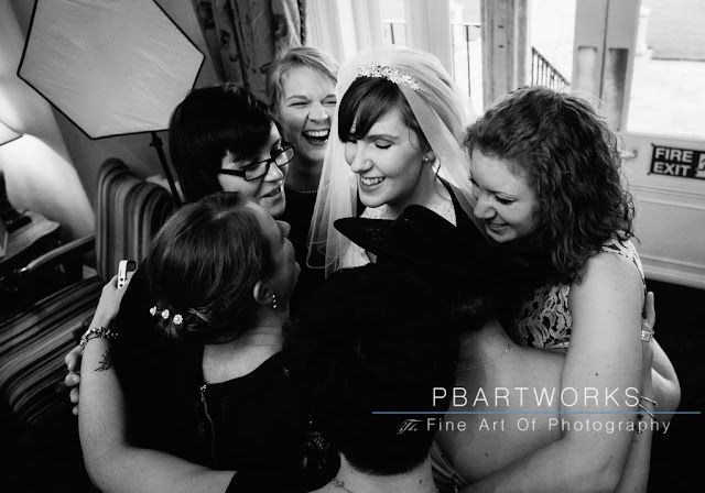 Bride in a group hug