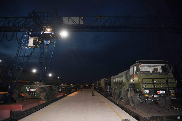 Image Attribute: Chinese military equipment is being loaded onto a train at a station. /Photo by Yang Zaixin, Chinamil.com.cn