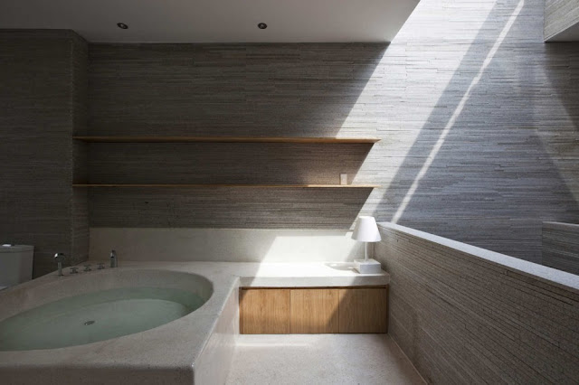 Photo of oval modern bathtub in the bathroom