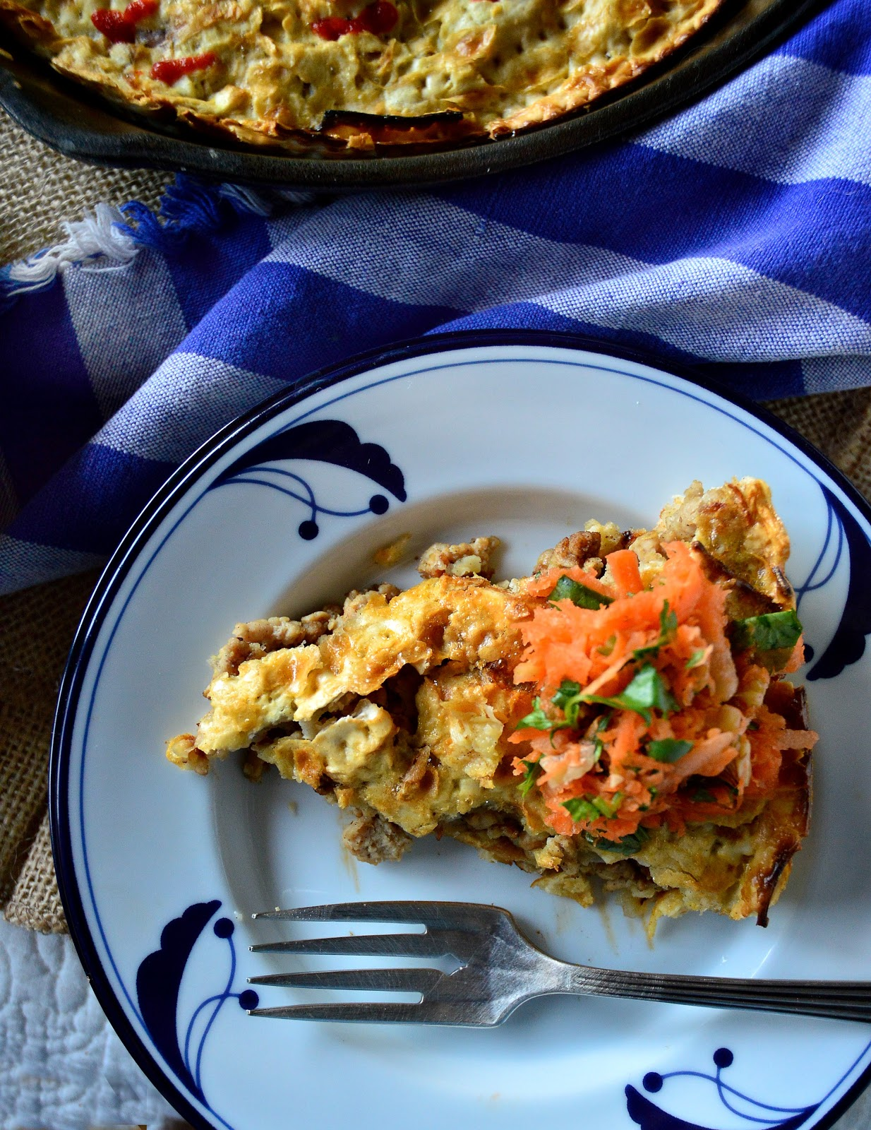 This cardamom coffee flavored ground chicken is cooked with onion and garlic and stuffed into a matzoh pie shell. Topped with a carrot salad this is a new way to do dinner! #matzoh #passoverrecipes #pie #cardamom www.thisishwicook.com