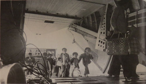 Vietnamese children boarding a plane in April 1975