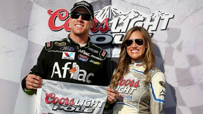 Carl Edwards with Miss Coors Light after winning the pole at Texas Motor Speedway.