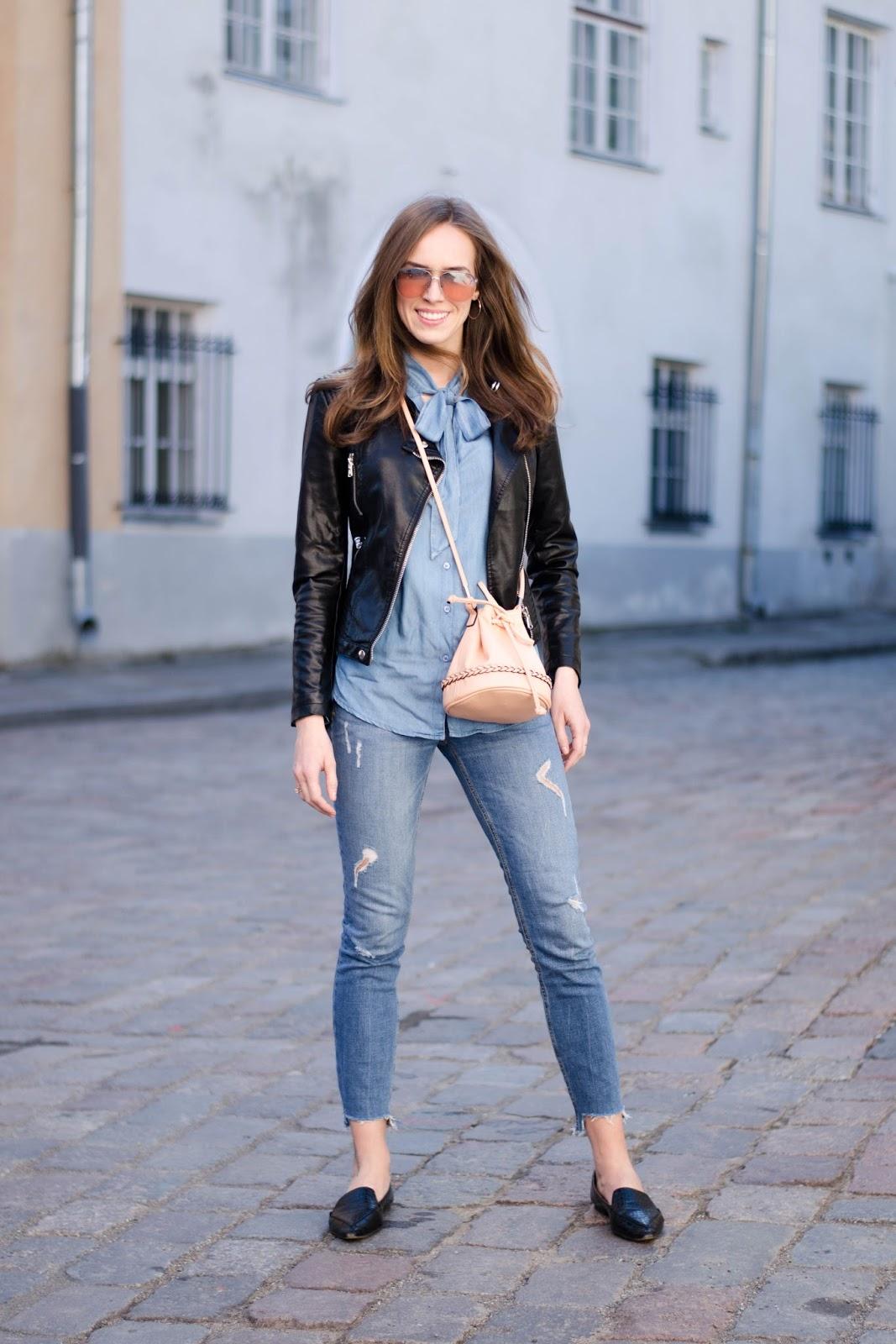 kristjaana mere spring outfit denim shirt ripped jeans