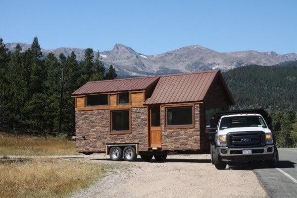 01-Home-Transportation-Simblissity-Tiny-House-Stone-Cottage-on-Wheels-www-designstack-co