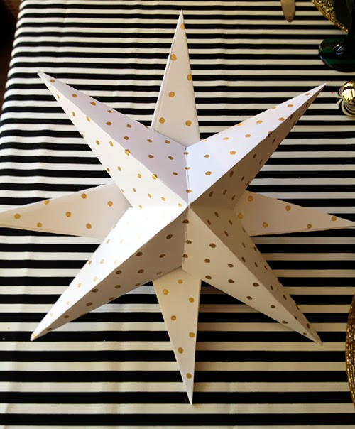 make a toilet paper roll Christmas tree topper Step 2: Cut 6 of the segments into two unequal pieces so that the smaller section measures about 3/4 inch in length and the larger one about 1 1/2 inches.