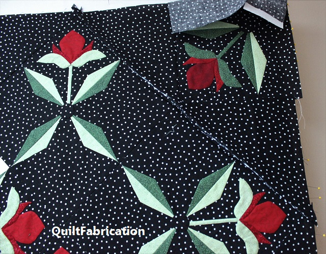 corners with glue on the Med Rose quilt
