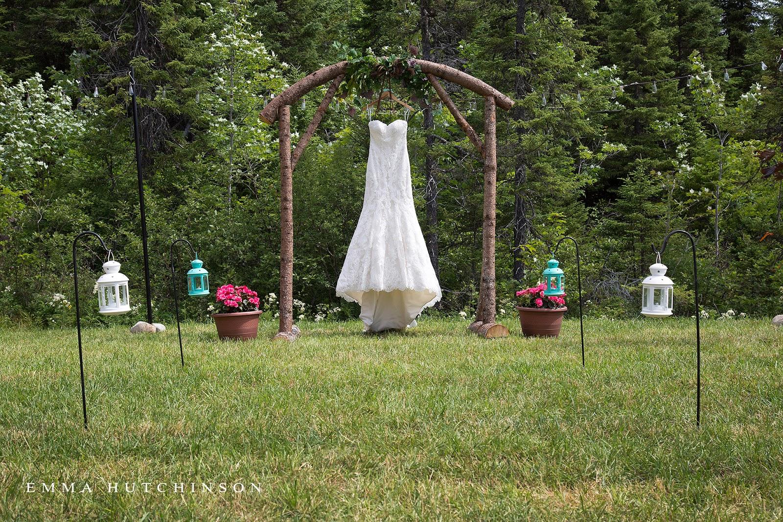 Newfoundland backyard wedding - wedding dress hanging in DIY wood arch