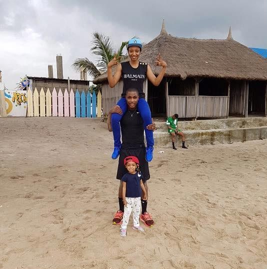 Jude Ighalo carries his wife and daughter on his shoulders after training