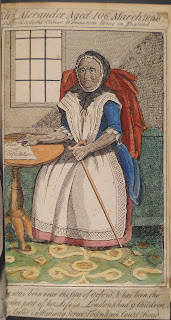 "A color illustration of an elderly woman seated at a table and holding a cane. The image is captioned, in part, with ""Eliz. Alexander, Aged 106, March 1808."""