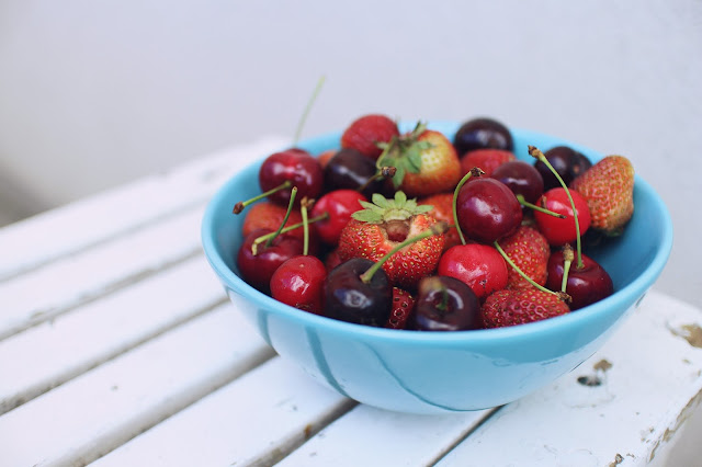 Bowl of cherries and strawberries