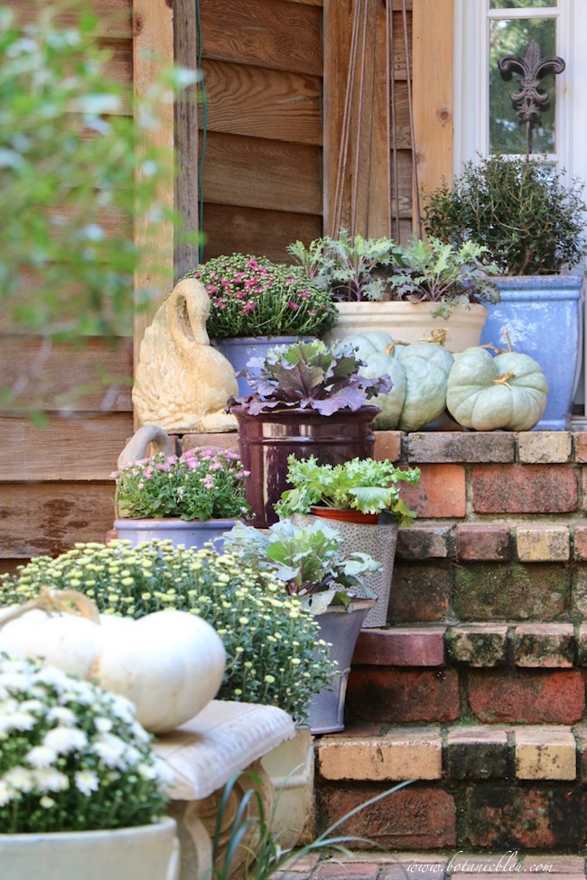 fall front porch decorating ideas with color on brick steps