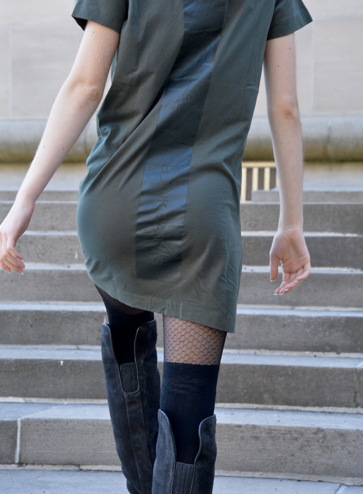 Walking up the stairs in a dress with tights and over the knee boots