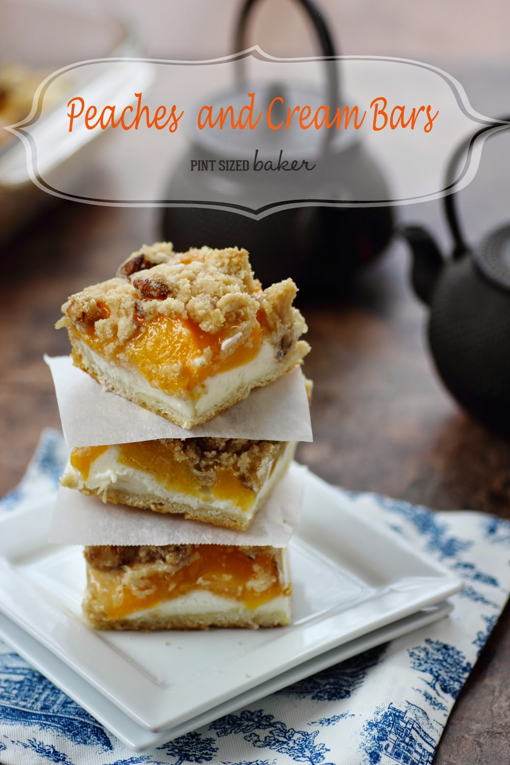 Sweet Cookie Bars with cream cheese, peaches and a walnut crumble topping.