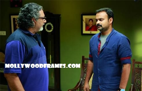 Chackochan and Joy Mathew in 'Law Point'