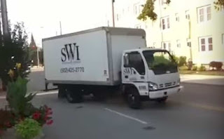 A Specific Waste Industries truck leaves Planned Parenthood after picking up the remains of aborted babies.