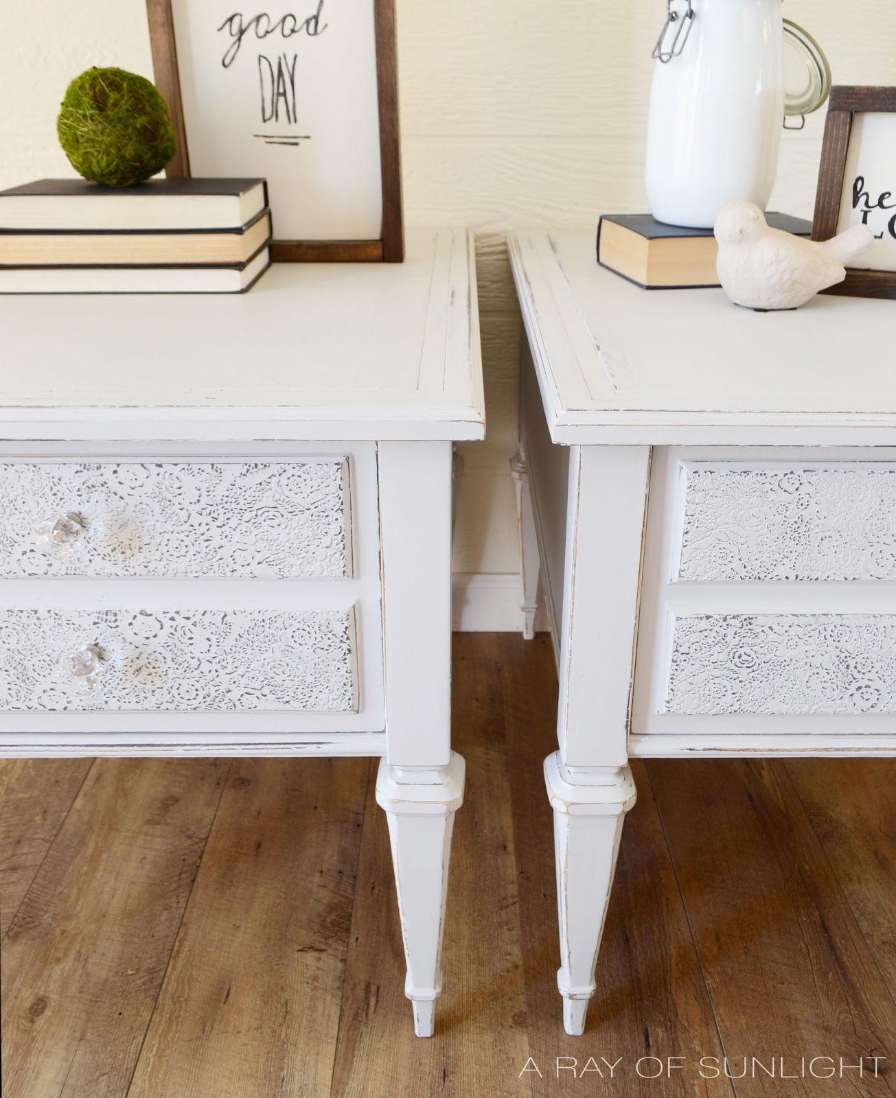 These adorable shabby chic nightstands were painted in a light  warm gray and got a special painting technique on the drawers. Check out the whole furniture makeover here! By A Ray of Sunlight