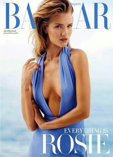 Rosie Huntington-Whiteley shows off cleavage for the Harper's Bazaar Australia January/February 2015 Cover