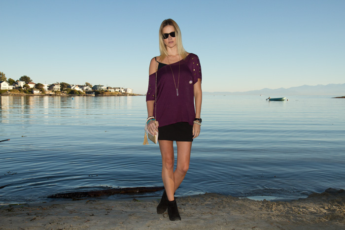 Vancouver Fashion Blogger, Alison Hutchinson, wearing Urban Outfitters studded shoulder burgundy top, bodycon black mini skirt, suede black boots, H&M pink and gold bag, True Worth Design clear quartz crystal pendant necklace, XO Bella skull bead bracelets