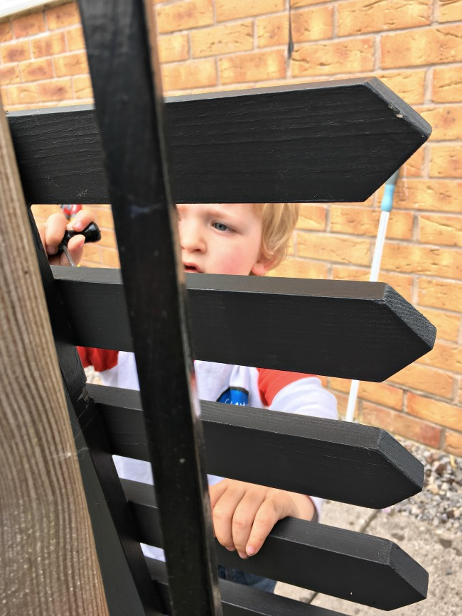 picture-of-toddler-through-picket-gate-with-awl