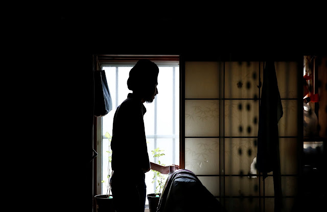 Image Attribute: Gursewak Singh is silhouetted against a window in a room of his house while he has an interview with Reuters, in Matsudo, Japan, September 25, 2016. REUTERS/Kim Kyung-Hoon