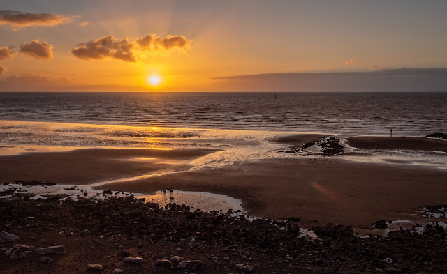 Photo of sunset on the shore at Maryport