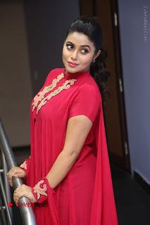 Actress Poorna Latest Stills in Red Dress at Rakshasi First Look Launch  0190.JPG