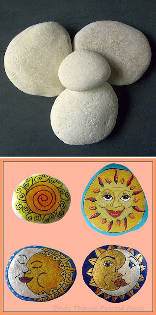 Suns and Moons painted on rocks by Cindy Thomas