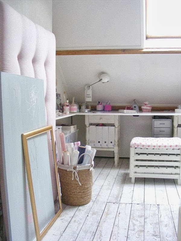 Scandinavian white wooden floors in attic craft room