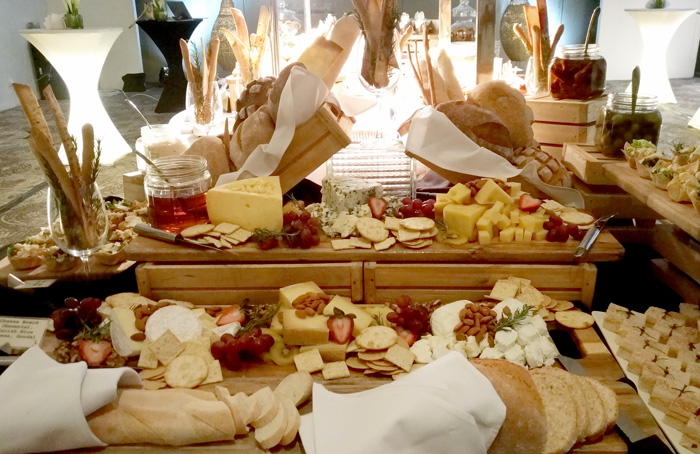 Various cheeses, fresh fruits and biscuits to pair the wine